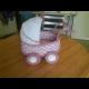 Pletený detský kočík.